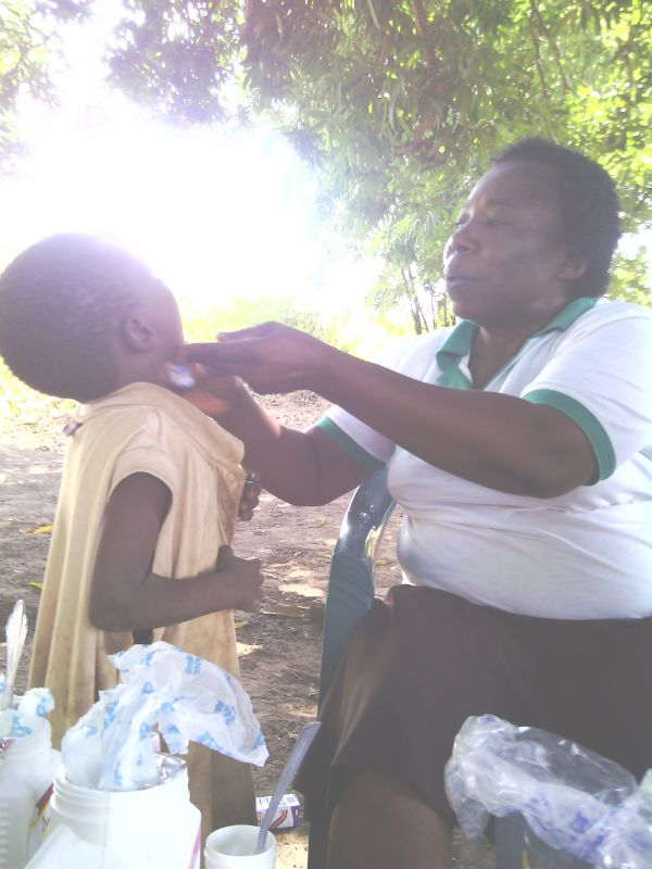 Adminstering treatment to a child in a medical outreach